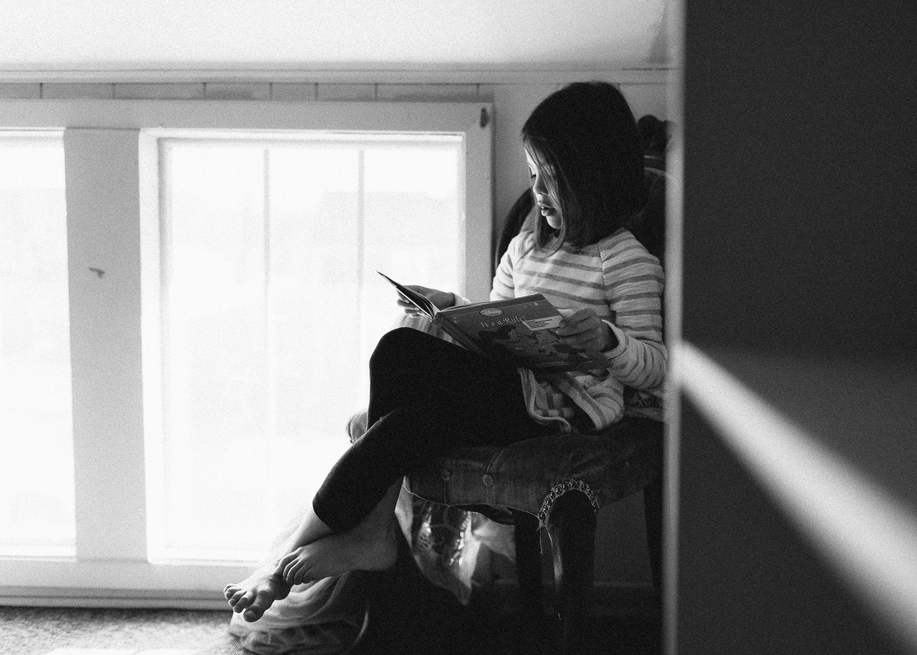 girl reading on chair