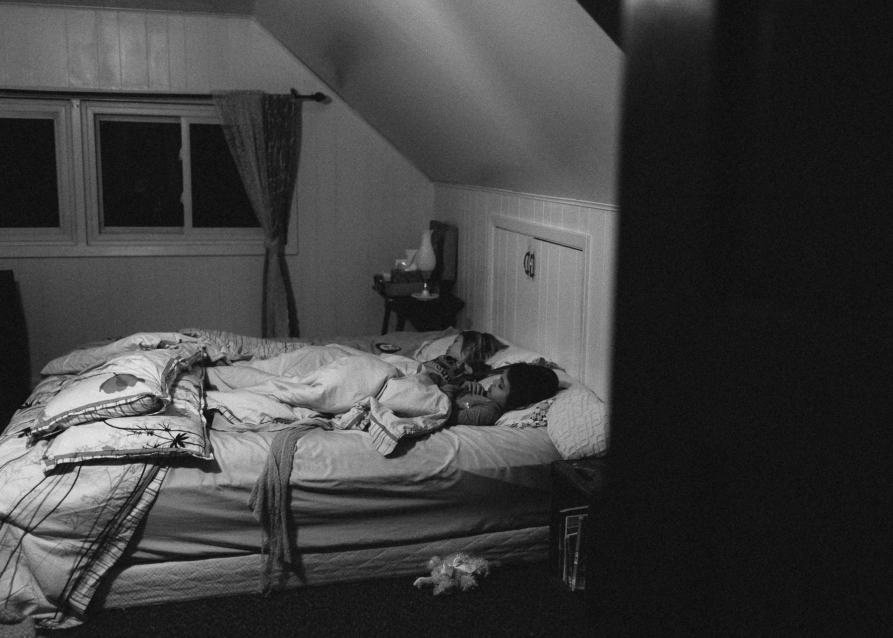 girl's sleeping in bed