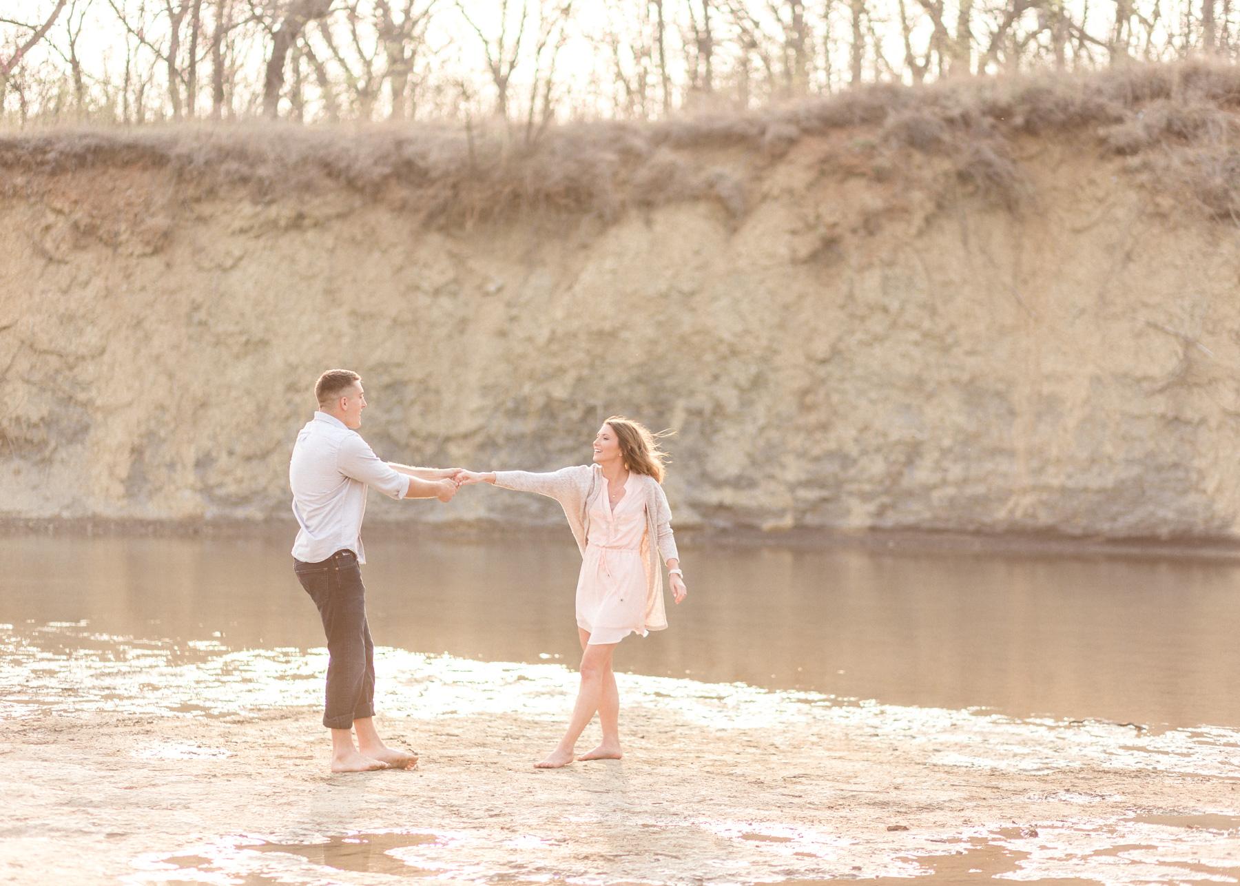two dancing near water