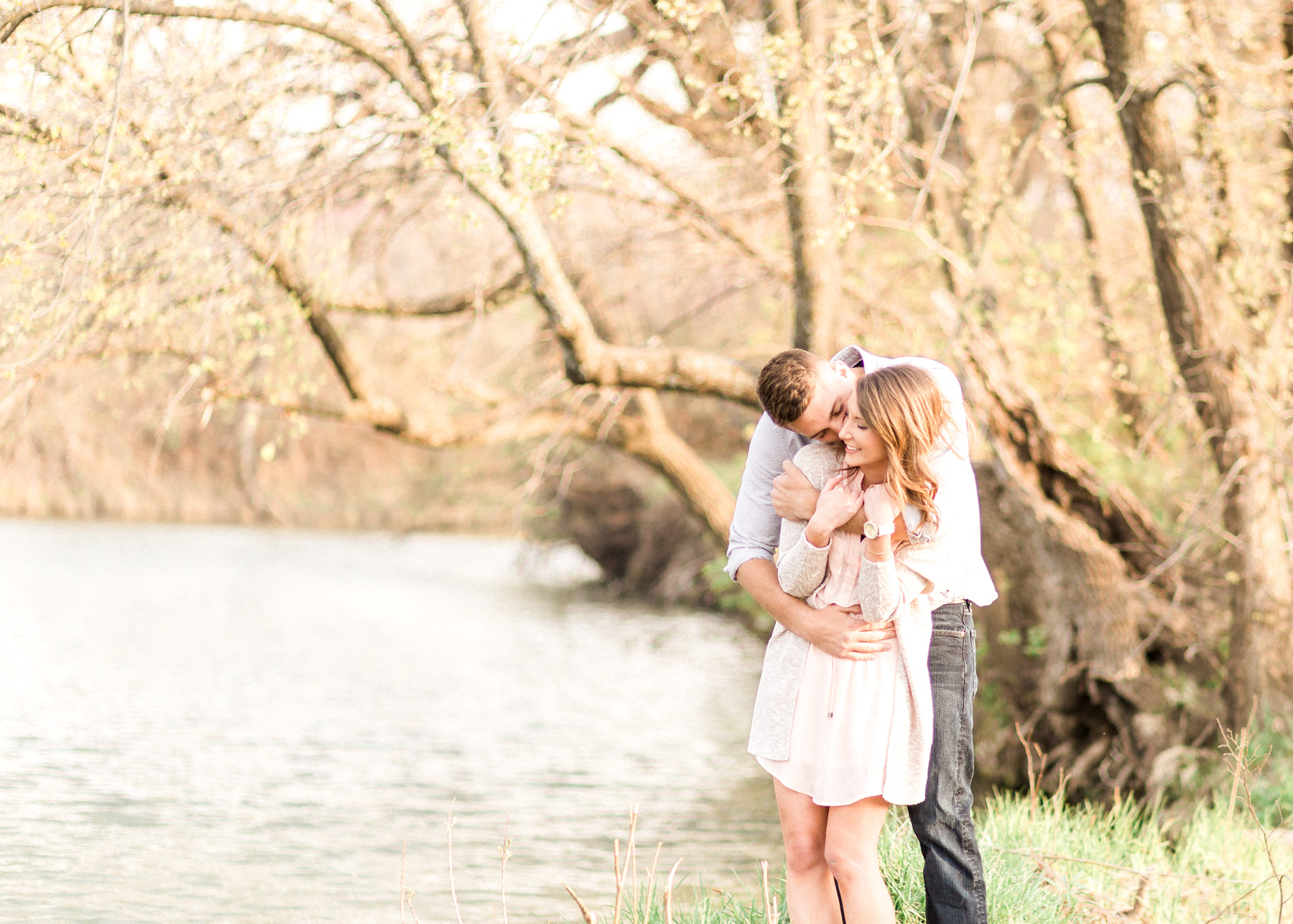 abby and zach hugging by water