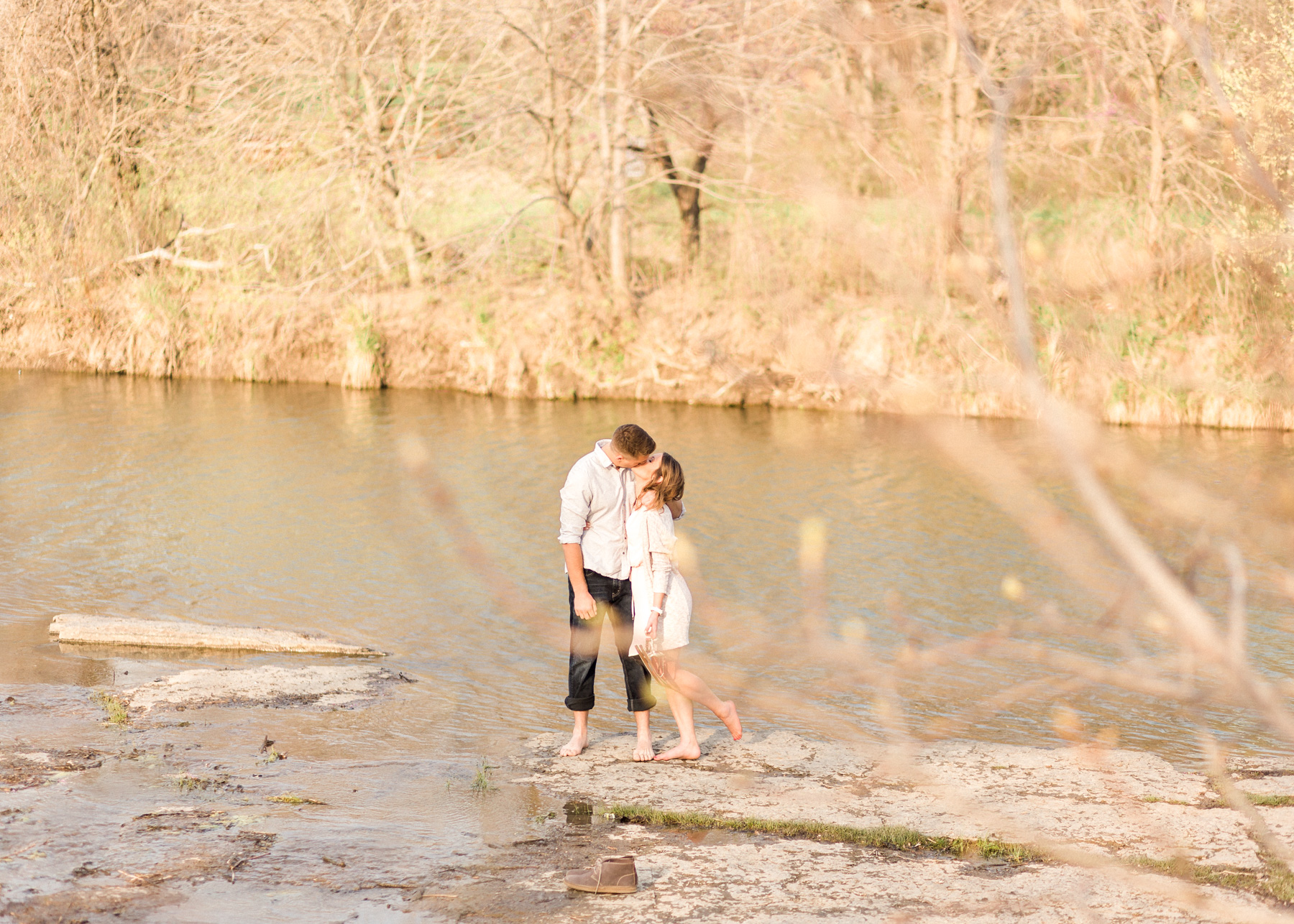 abby and zach kissing near water