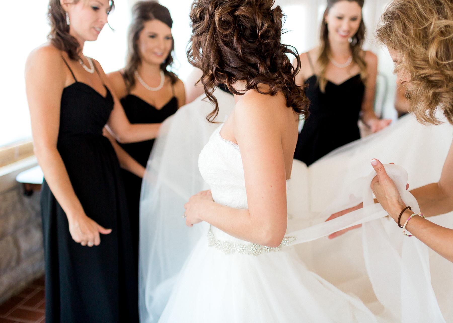 tying bow on wedding dress