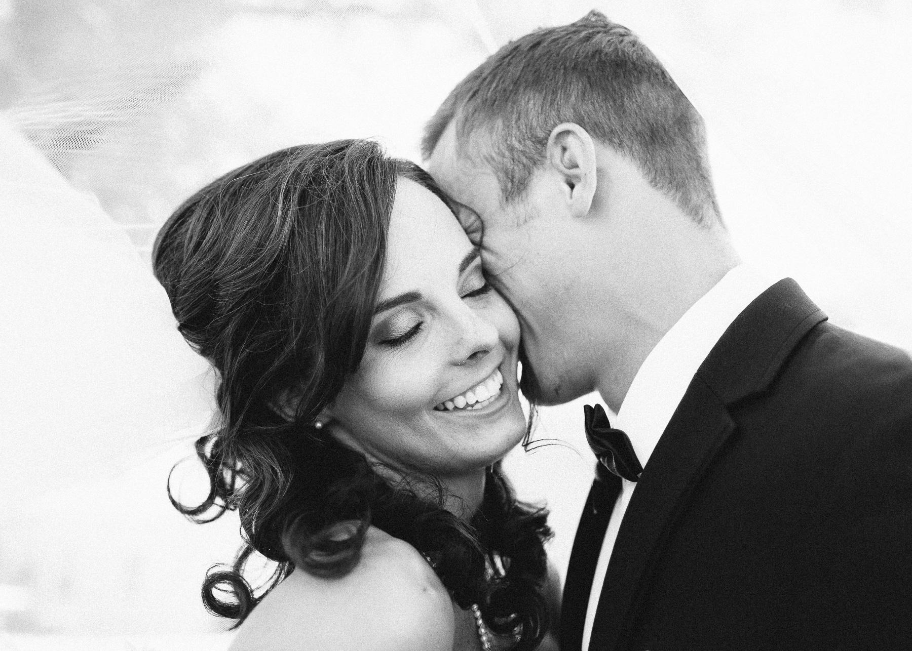 bride smiling underneath veil
