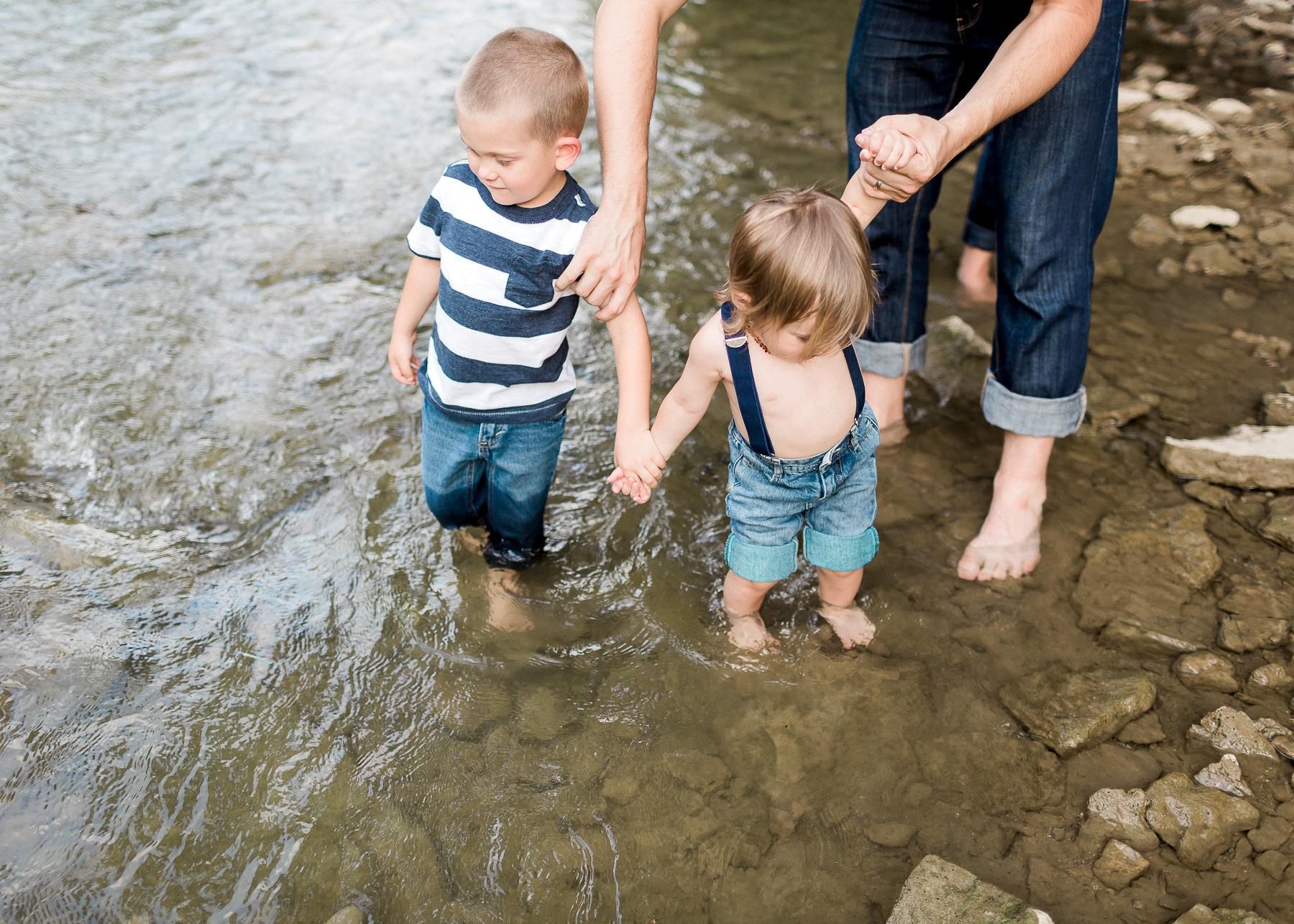 brothers walking in creek