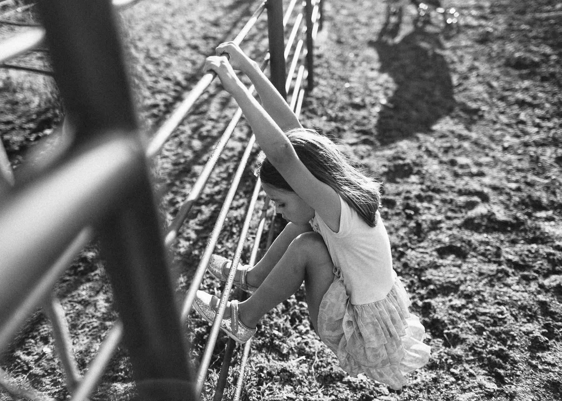 girl swinging on railing