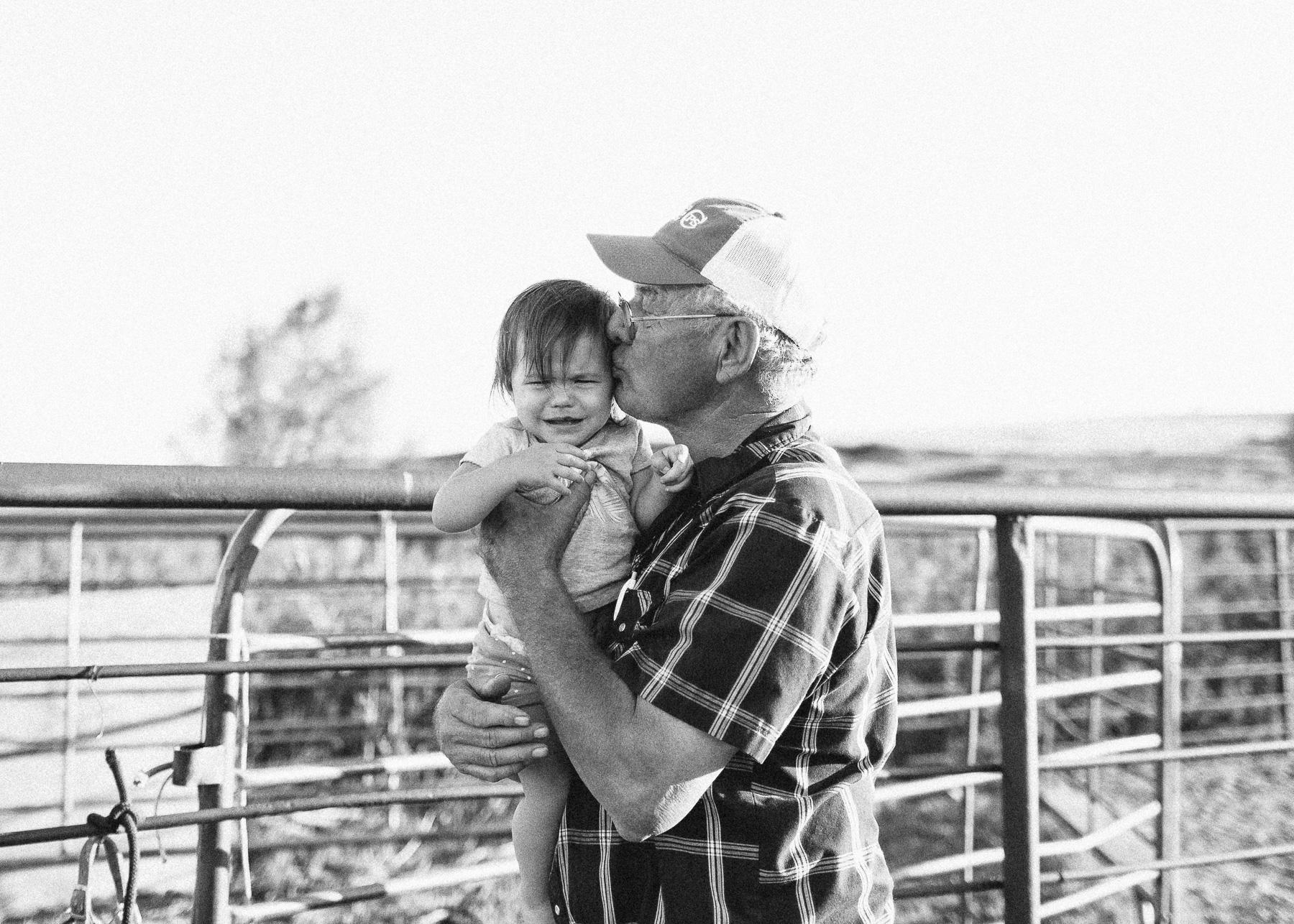 papa kissing baby