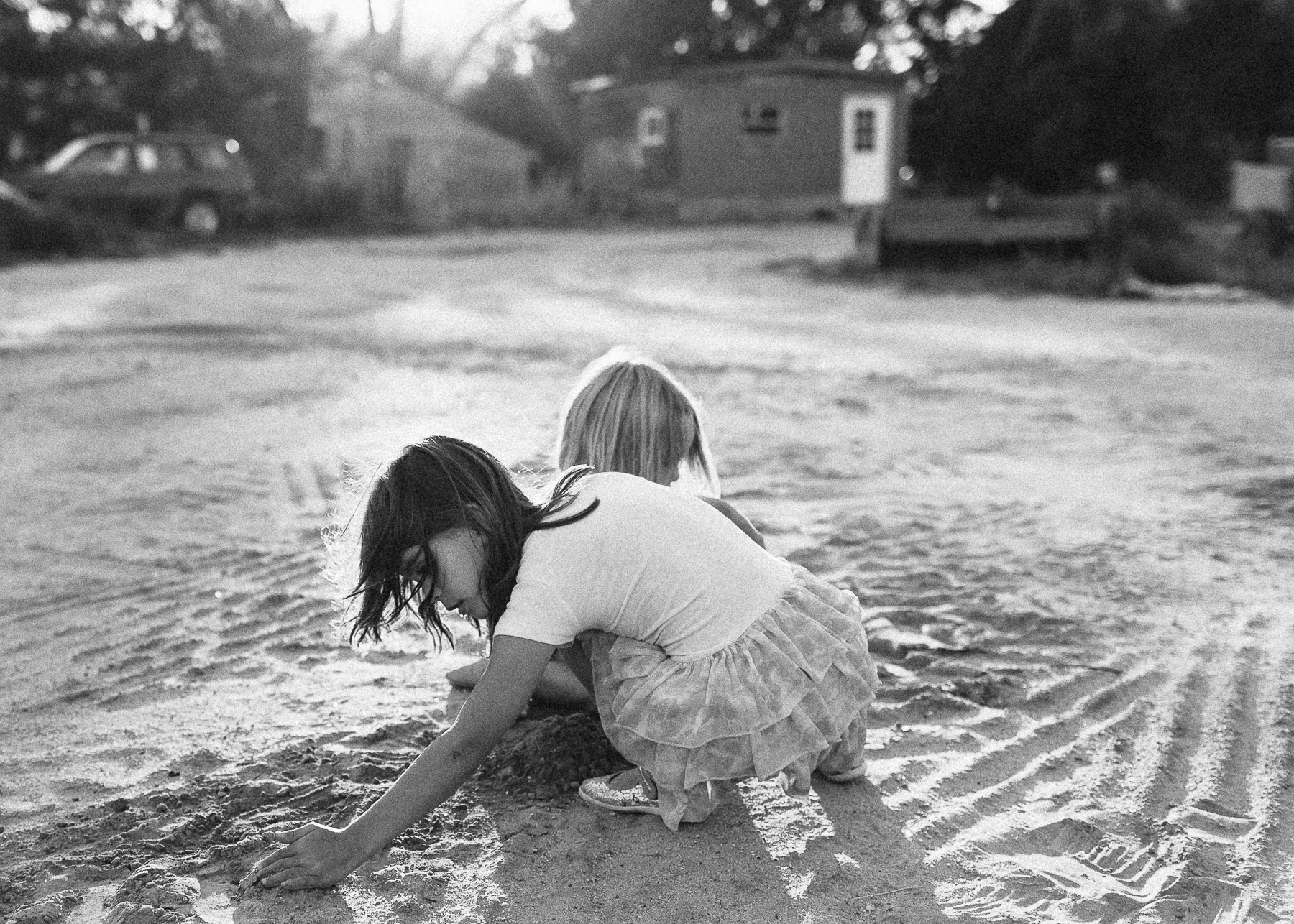 girls playing in dirt
