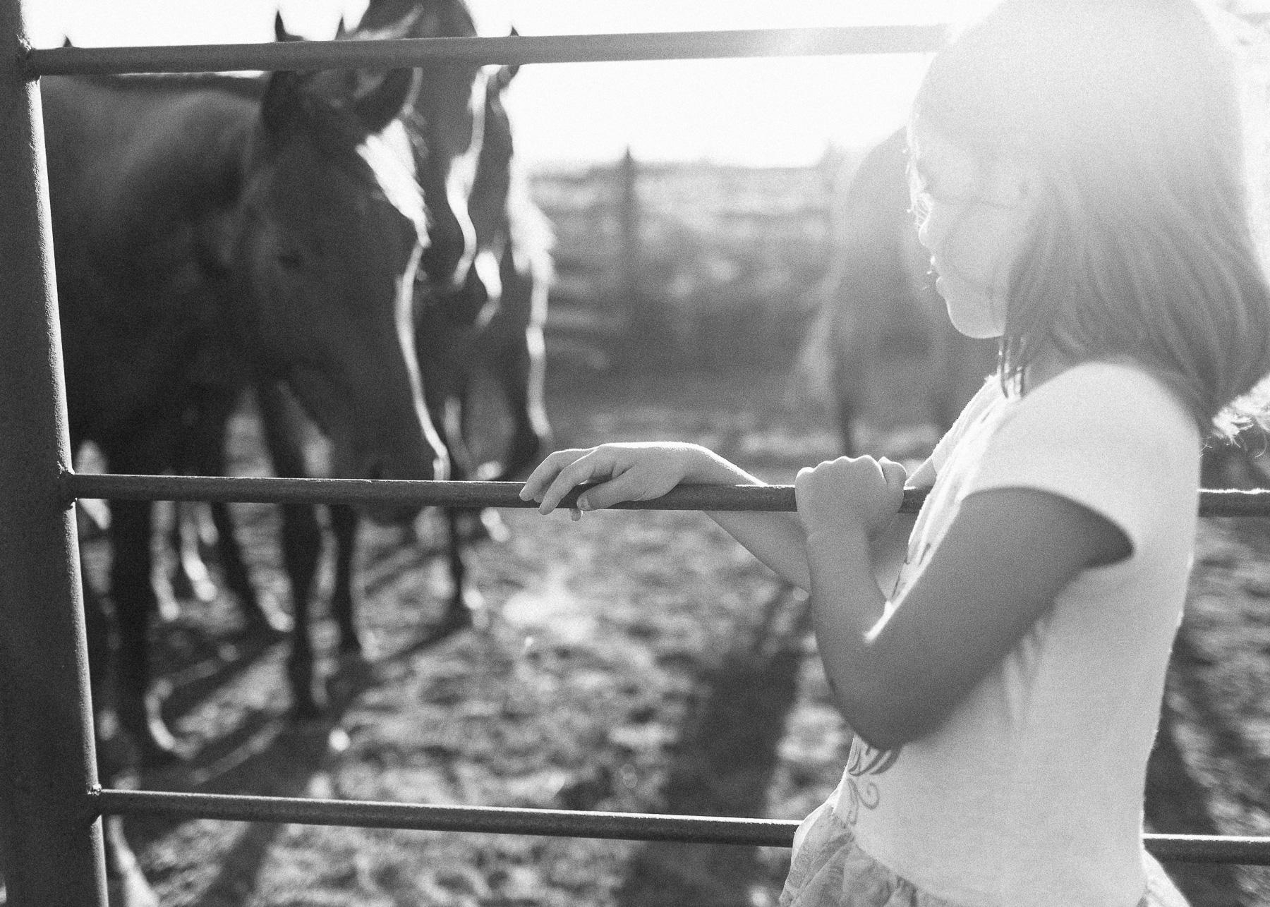 girl on fence rail