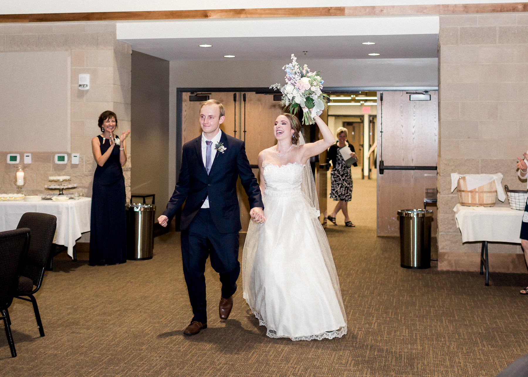 bride and groom enter reception