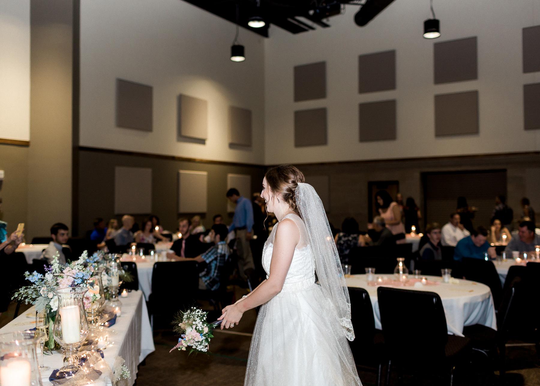 bride throwing her bouquet