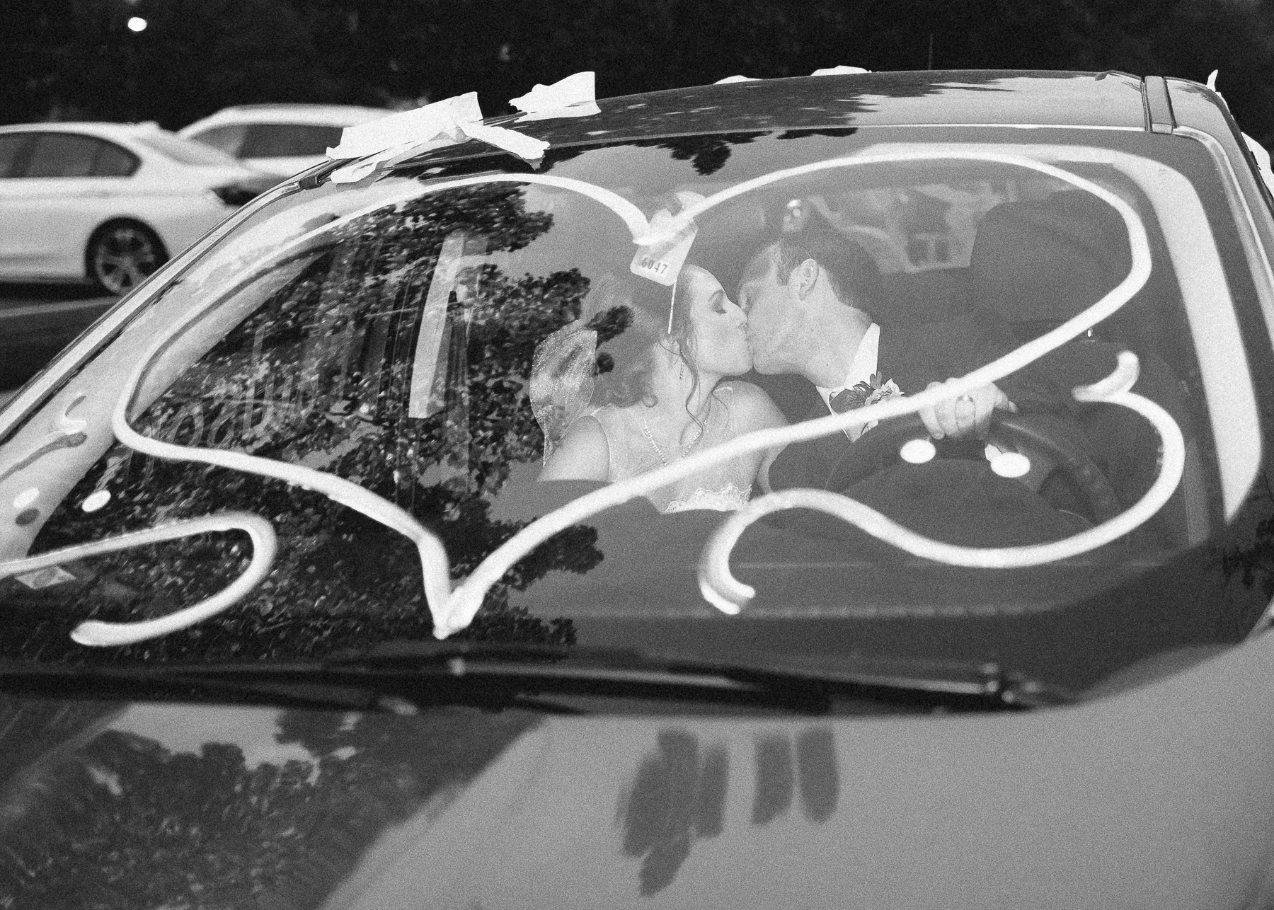 bride and groom in get-away car