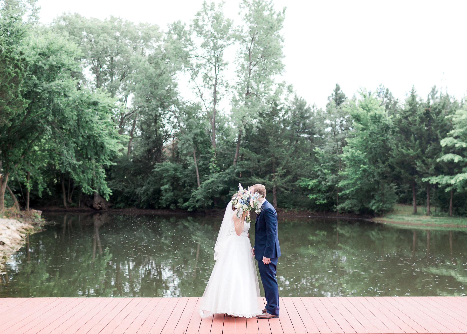 kiss on dock during first look