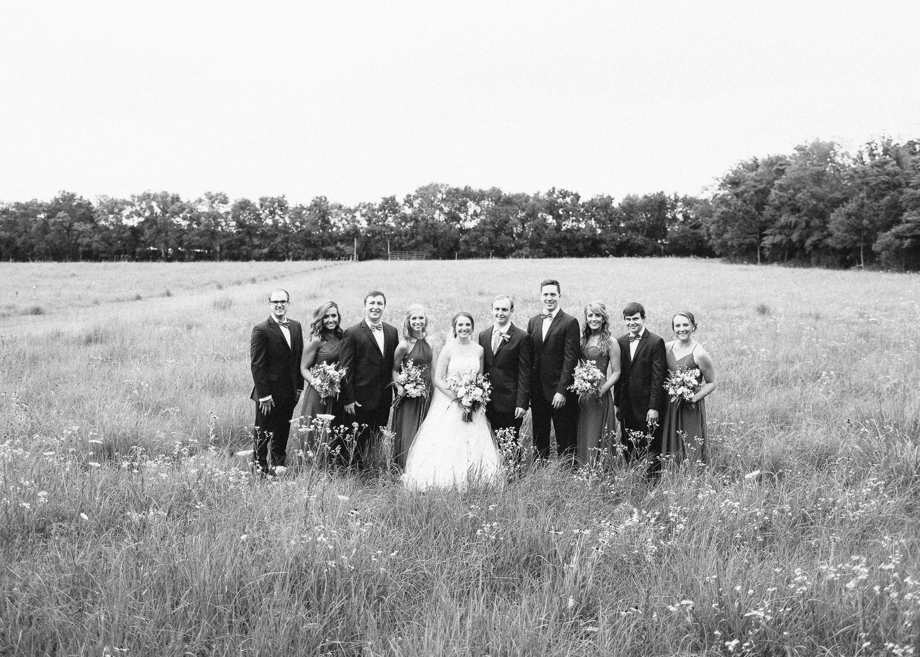 bridesmaids and groomsmen with bride and groom portrait
