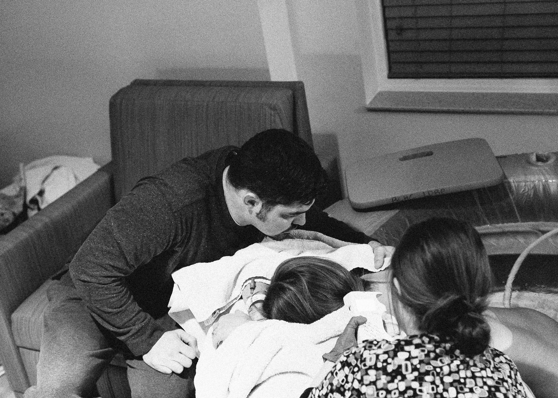 father helping wife breathe deep
