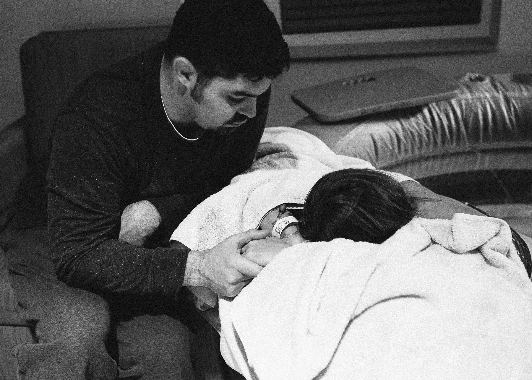 husband holding wife's hand during contraction