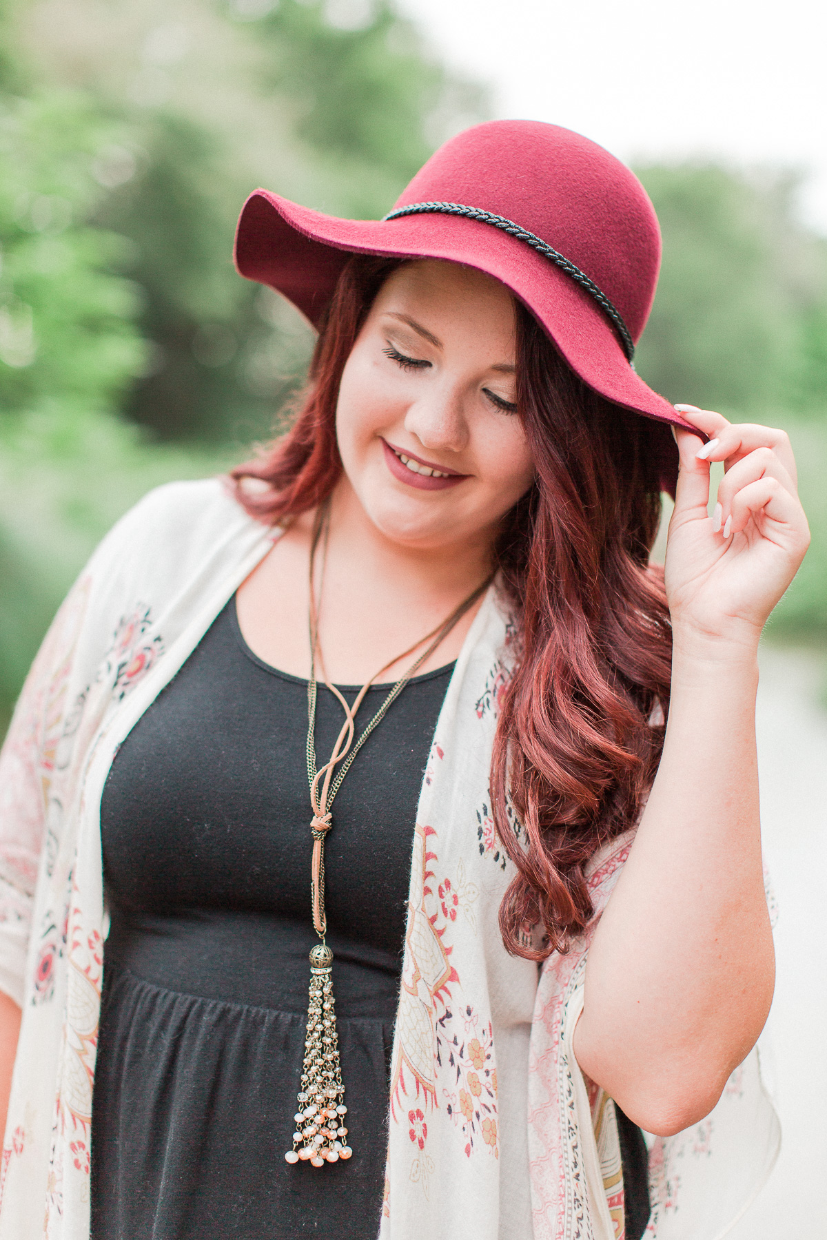 Mollie holding hat