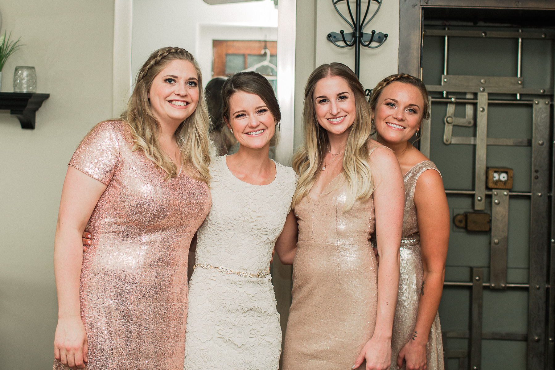 Bridesmaids and bride smiling