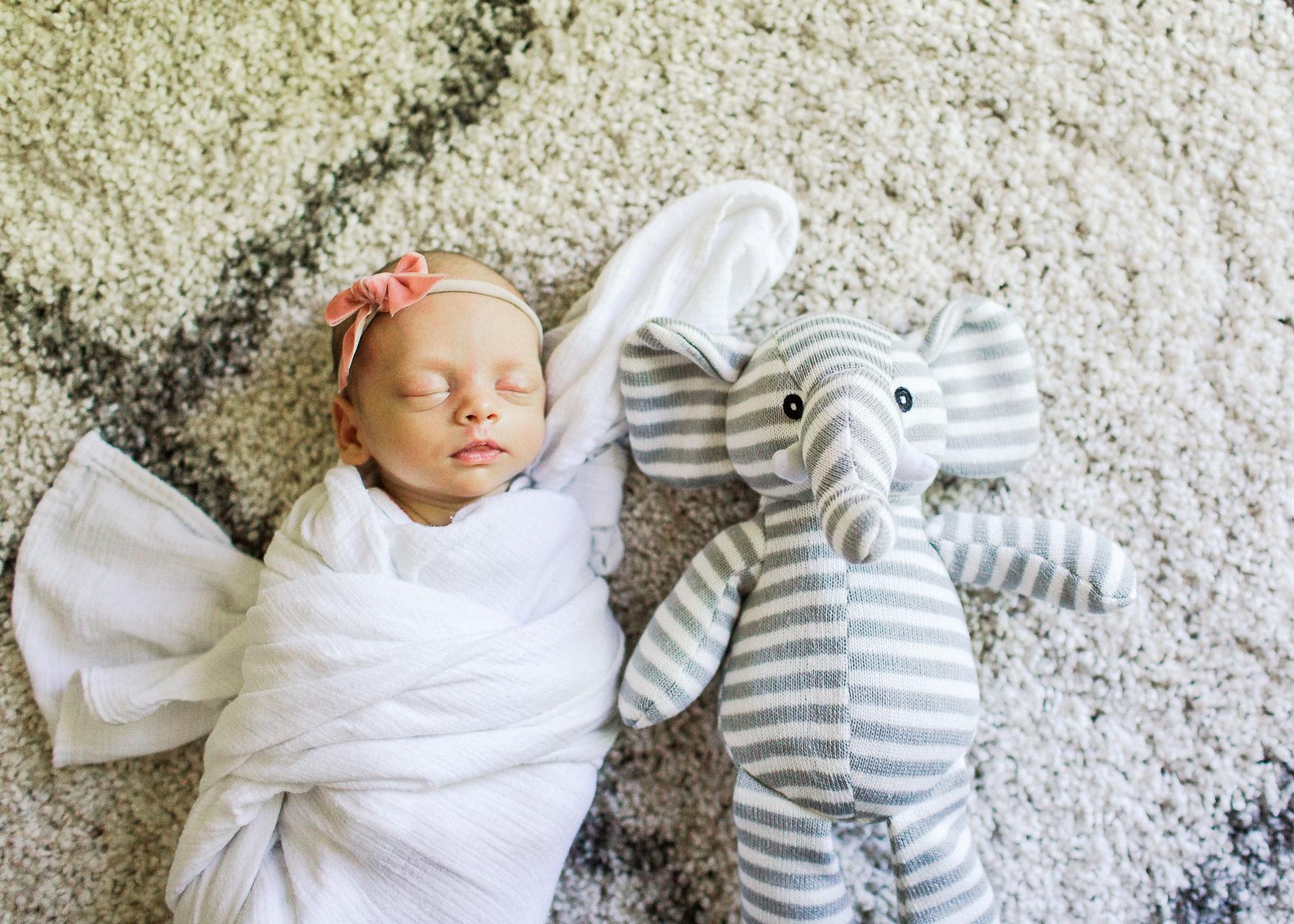 baby next to elephant stuffy