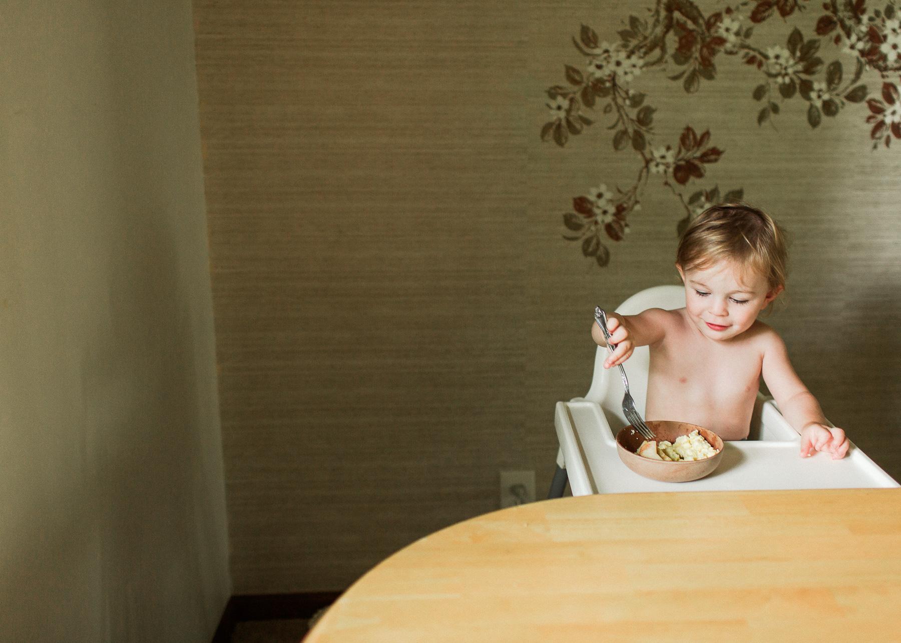 son eating breakfast