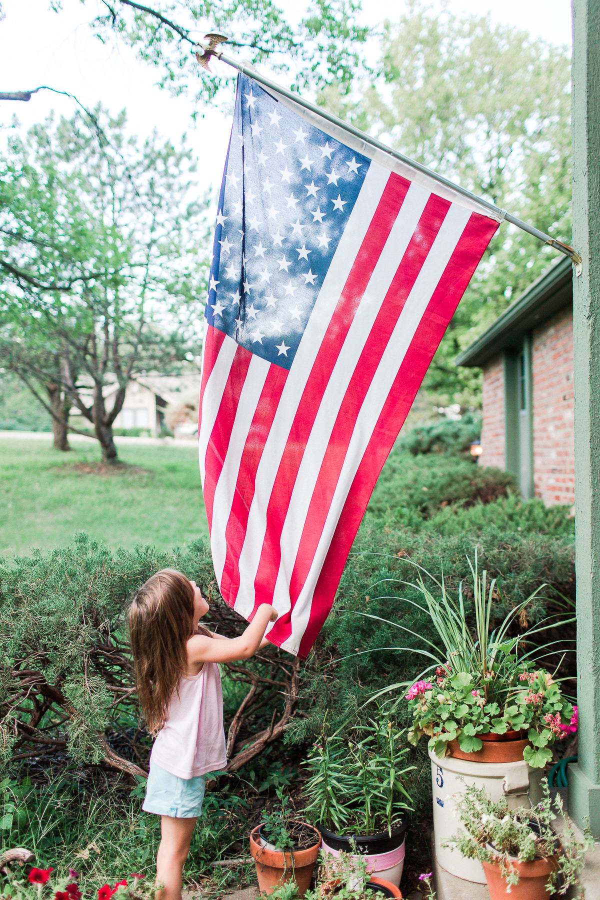 daughter pointing at American Flag