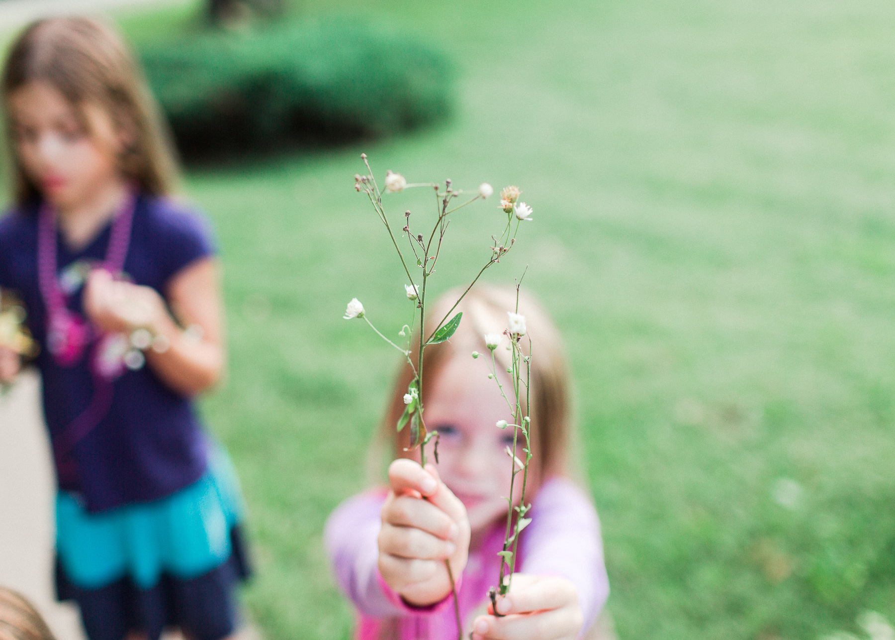 homeschooling daughter holding flowers