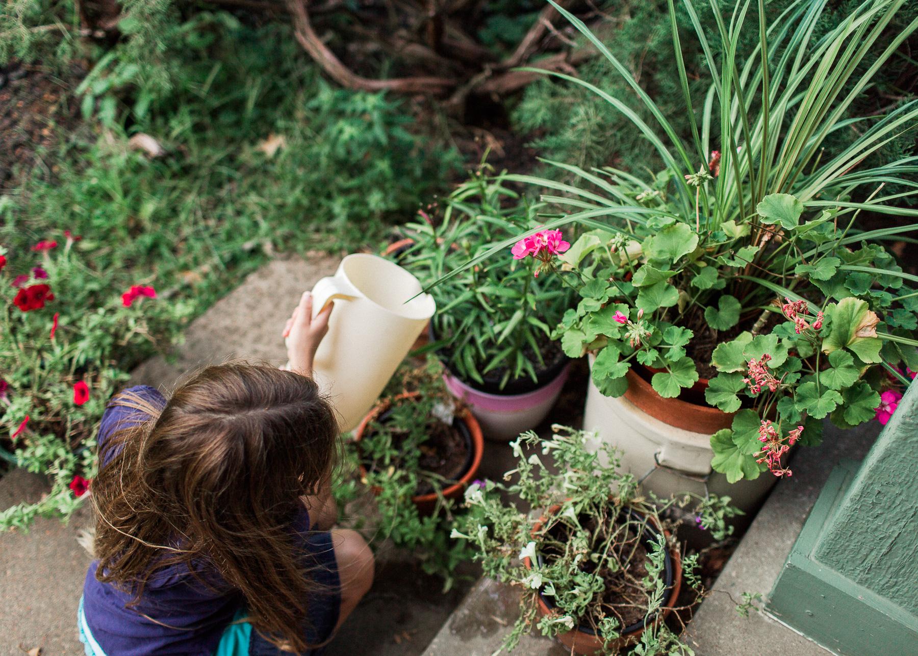 homeschooling daughter watering plants